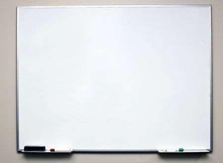erase: Clean dry erase board on a off white wall with markers in the tray