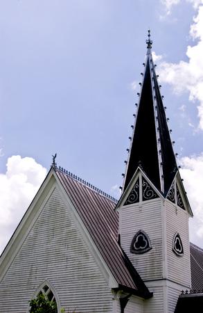 An ornate church steeple taken against a bright blue sky.  Stock Photo