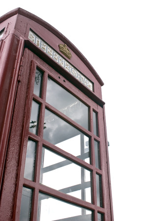 antique booth: A red antique british phone booth. Stock Photo