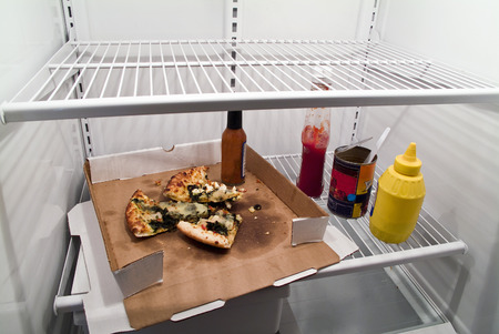 fridge: Shot of an almost empty refrigerator showing bad nutrition
