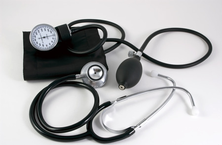 sphygmomanometer and stethoscope taken on a white card photo