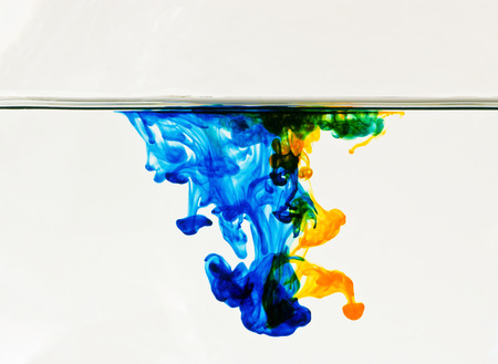 Abstract background of colorful dye drifting through water 스톡 콘텐츠