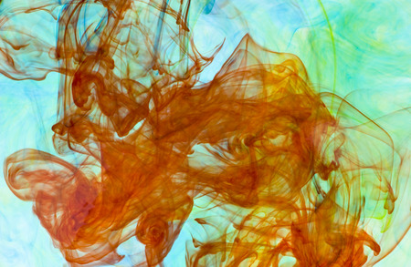 Abstract background of colorful dye drifting through water Imagens