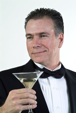 suave: A man in formal attire, with a loving expression on his face and a martini glass in his hand.
