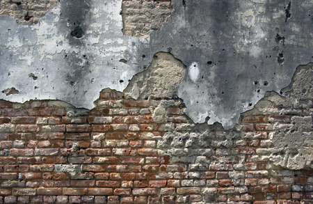 apart: old brick wall falling apart with age and decay, usefull for background Stock Photo