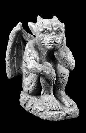 gargoyle: Closeup of a small porous stone gargoyle Stock Photo