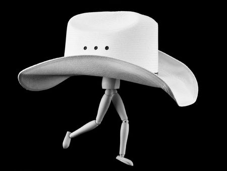 A little stick man staged as if running, wearing a large cowboy hat. (black and white) Reklamní fotografie