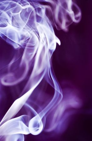 broaden: The graceful swirls of smoke from burning insence illuminated with purple color.