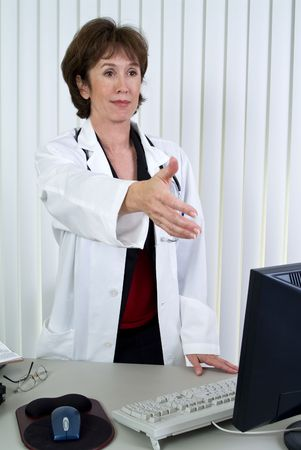 approachable: A woman dressing as a doctor extending her hand as if ready to greet someone.