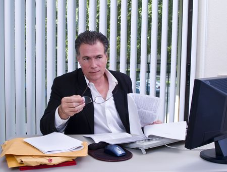 divulge: A man with a legal size document in his hands acting as if he is telling someone something.  Stock Photo