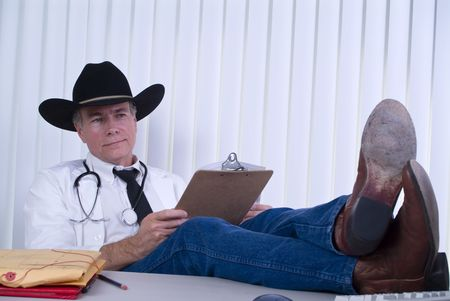 A man dressed in a manner as if to suggest he is a large animal veterinarian, or a country doctor.  Stock Photo