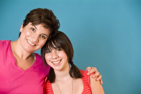 single parent family: A woman and a girl representing a happy mother and daughter. (blue screen) Stock Photo