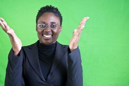 An attractive African American woman raising her hands as if excited or enthused. Banco de Imagens - 3903433