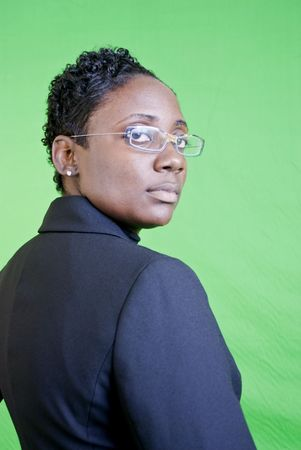A young African American businesswoman with an attitude of confidence or superiority. Stock Photo