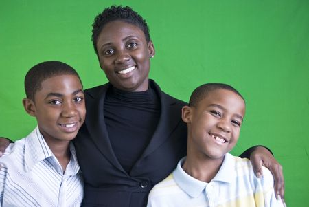 family and friends: A young African American mother and her two young boys.