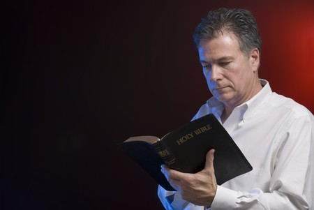 gels: A man reading a bible, background and side lighting with red and blue gels.