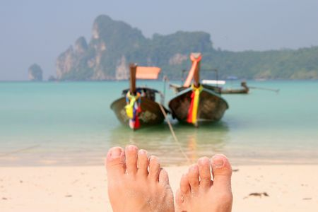 longtail boats in turquoise waters, Phi Phi Islands, Phuket, Thailand Stock Photo