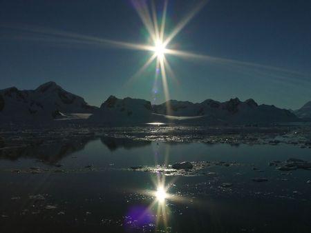 Reflection of sun, Antarctica photo