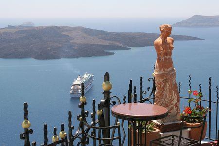 Statue of a woman in Santorini, Greece photo