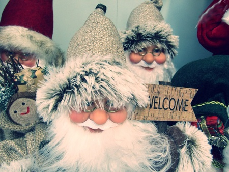 Group of Father Christmas decorations with a welcome sign