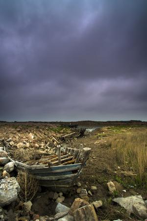 abandonment: abandoned wooden boat