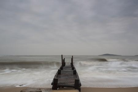 Beach scenery wooden trestle