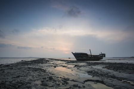 abandonment: Tidal flats fishing boat