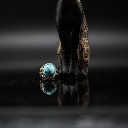 Wood carving cat with turquoise ring