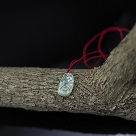 coral bark: Jade pendant