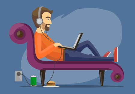 unshaven: man wearing headphones lying on the sofa with computer