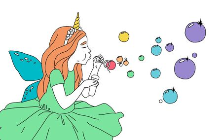 Cute girl in a fairy costume blowing soap bubbles