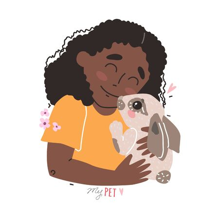 Lovely friendship with pet. Little Black african american cute girl hugs rabbit.
