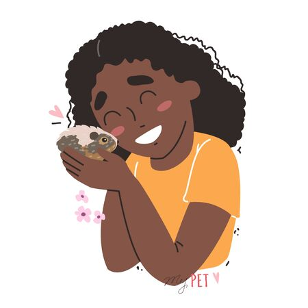 Black african american little girl holding a hamster in her arms