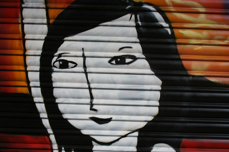 lockup: Asian woman grafitti