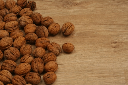 spreaded: Scattered walnuts on the wooden floor