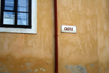 flaked: Old wall with flaked surface, stylish window and red drip pipeline in ?esk? Krumlov, Czech Repoublic Stock Photo