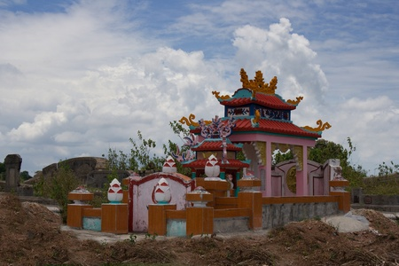 Vietnamese tomb in the cemetery surrounded by hill of clay. Typical vietnamese tomb - vault. Hue, Central Vietnam, Asia