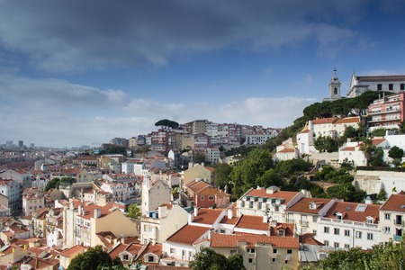 convento: Beautiful view from Costa del Castelo street towards Augusto Gil gardens Jardim Augusto Gil with beautiful church of the Grace Igreja Convento da Graca, Alfama, Lisboa, Portugal Stock Photo