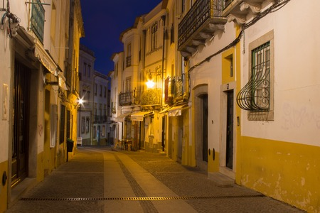 Night street of Evora city with lantern lights and blue night sky Stock Photo