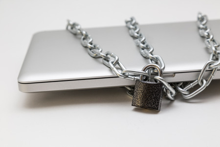 locked in: Laptop locked in chain Stock Photo