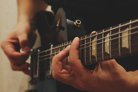 Man playing on guitar photo