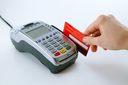Paying with credit card terminal Foto de archivo