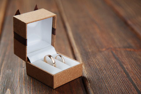 Golden wedding ring in the brown box
