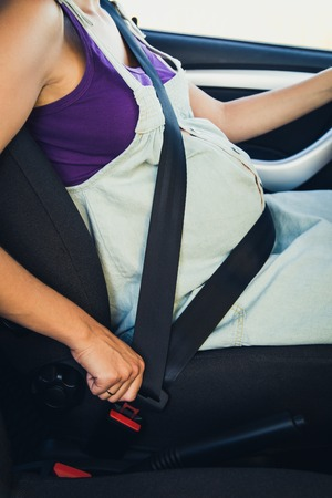 belts: Pregnant woman wear safety belt in the car
