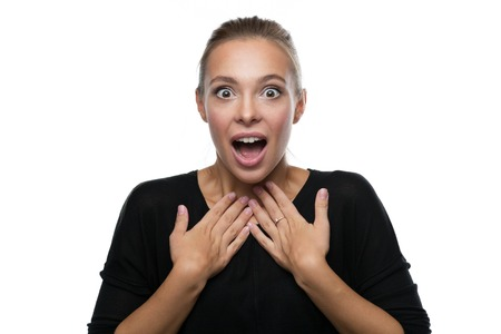 Portrait of surprised beautiful blond woman on white background