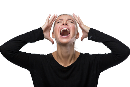 Portrait of stressed blond woman on white background