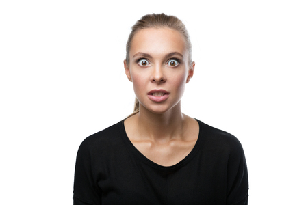 Portrait of beautiful angry blond woman on white background Stock Photo