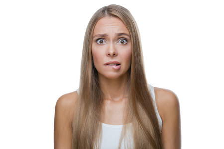 Portrait of shocked beautiful blond woman on white background