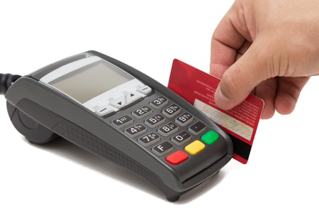 swipe: Hand swipe red credit through payment terminal