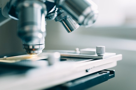 background people: Microscope in the Laboratory, modern close-up shot